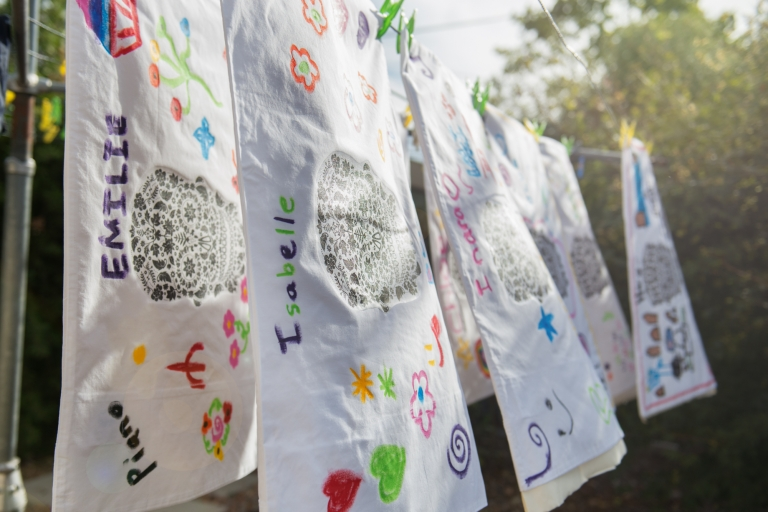 Decorated pillow covers hung to dry