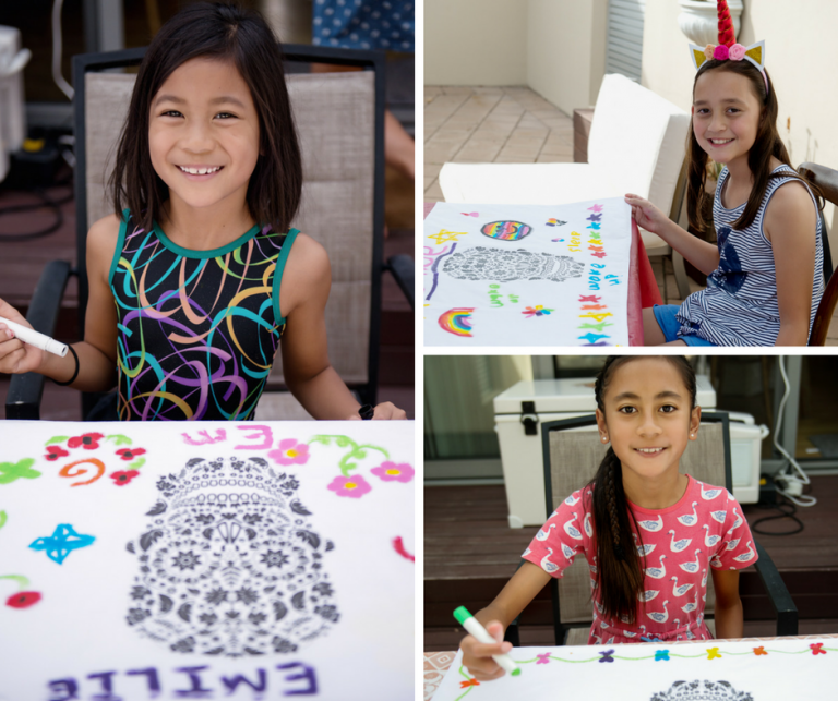 birthday party guests decorating pillow covers