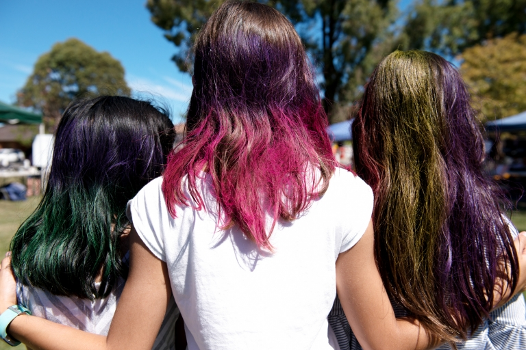 wacky hair colours on three girls at the fete